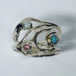 Broad swirly Silver ring set with blue Topaz