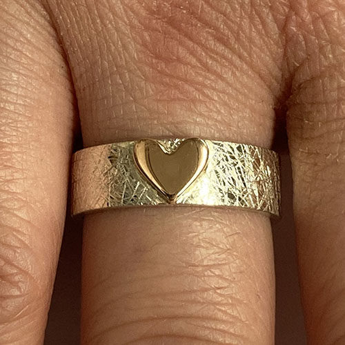 White gold band with yellow heart