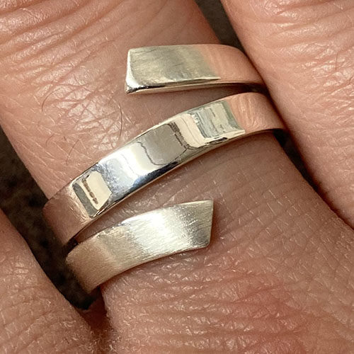 Solid Silver wrap around ring with satin finish