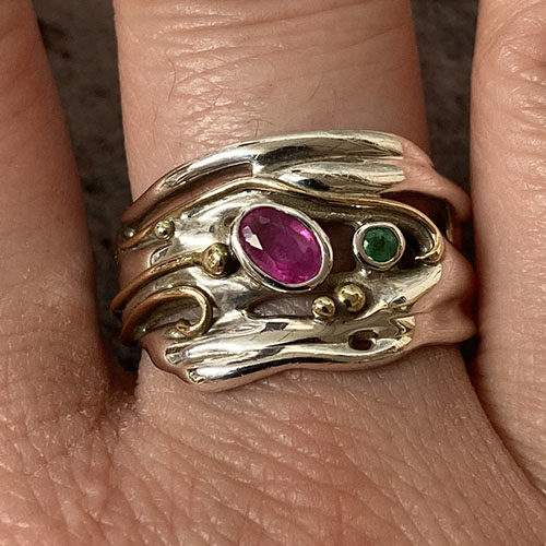 Silver Ring With An Oval Ruby And Round Emerald