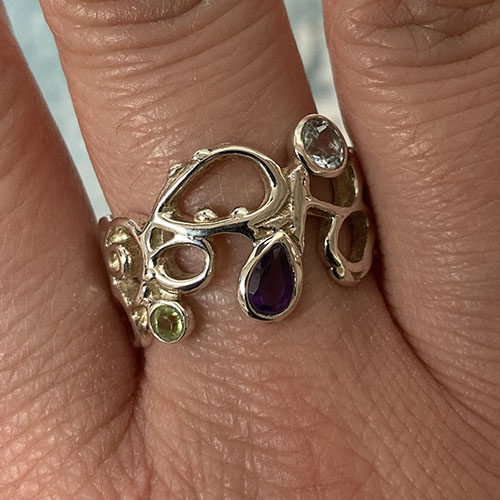 Multi Stone Silver Ring Set With A Teardrop Amethyst