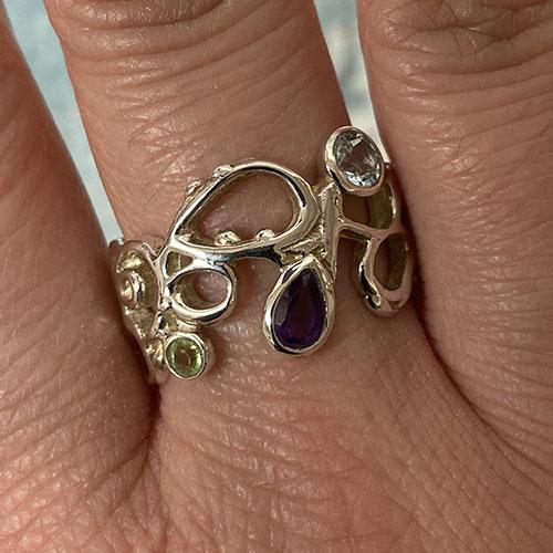 Multi Stone Silver Ring Set With A Teardrop Amethyst