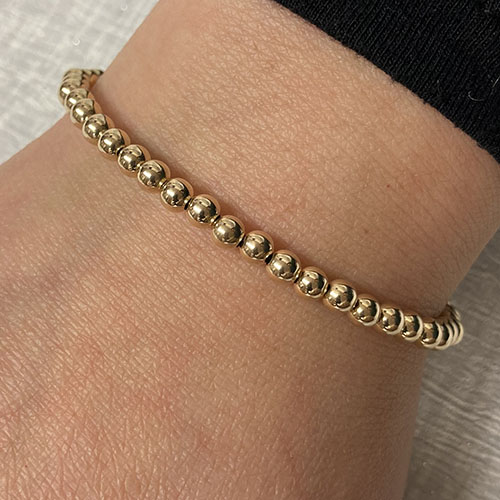 Yellow gold bracelet with T bar