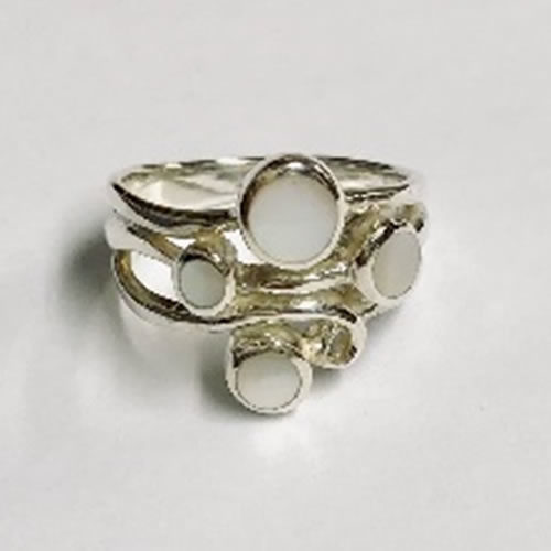 Silver Ring made up of four Mother Of Pearl Stones