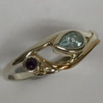Silver ring set with a Teardrop blue Topaz