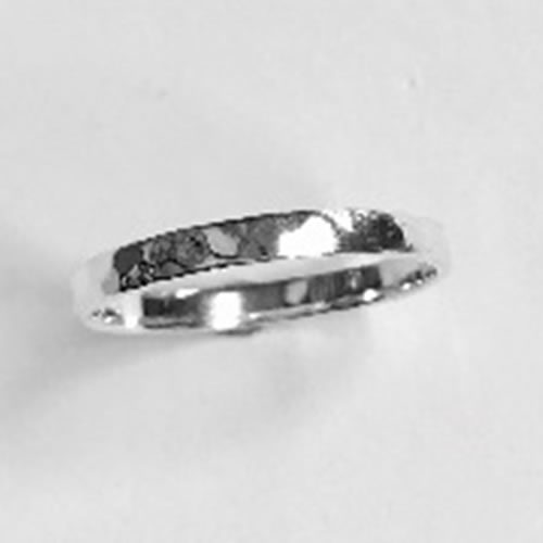 Solid Silver narrow band with a hammered texture
