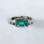 White gold ring with emerald