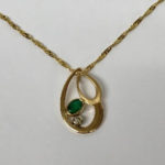 Yellow gold handmade pendant with emerald