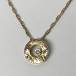 Yellow gold open disc pendant