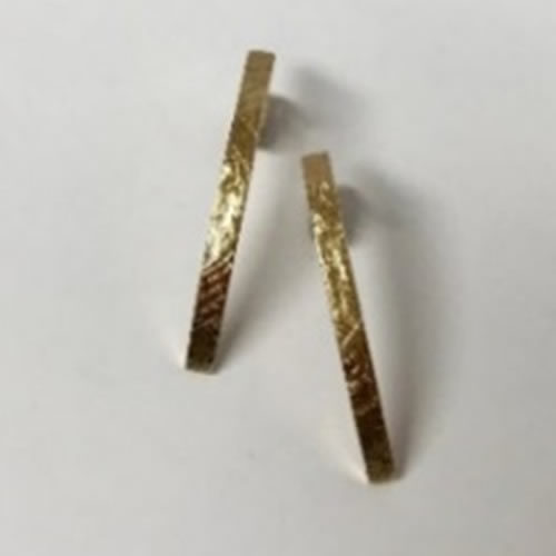 yellow gold earrings with a scratched finish