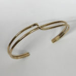 yellow gold torque style bangle