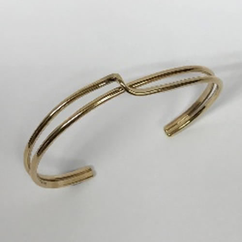 yellow gold torque style bangle