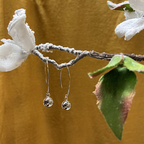 Sleek And Long Hook Earrings With An Silver Ball