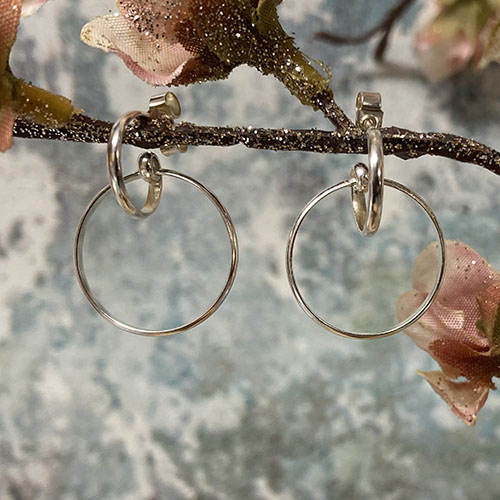 Silver Earrings Featuring A Small Hoop