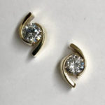 hand made gold and diamond stud earrings
