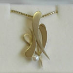 original design gold tear pendant