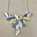 18-inch costume necklace with multi leaf drop in silver, pewter and gold colour