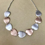 18-inch silver and rose gold coloured costume necklace in a matt satin finish