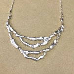 18-inch silver coloured costume necklace with matt satin finish