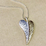 34-inch silver coloured costume necklace with rose gold and silver elongated heart drop