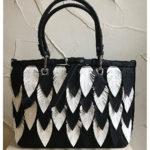 40cm x 25cm black and white feather detail fashion bag