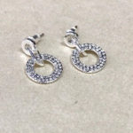 Costume earrings in a silver colour with sparkle effect finish