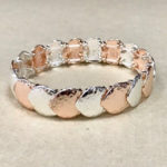Costume elasticated bracelet in a hammered texture rose gold and silver colour