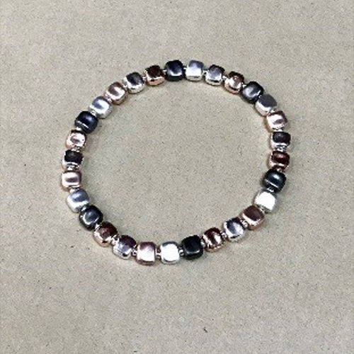 Costume elasticated bracelet in a matt rose gold, pewter and silver colour