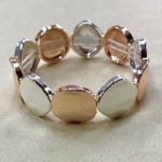 Costume elasticated bracelet in a shiny rose gold and silver colour