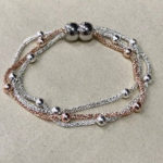 Costume mesh chain bracelet in rose gold and silver colour with magnetic catch