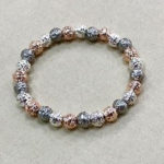 Costume rough textured elasticated bracelet in a rose gold, silver and pewter colour