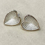Heart shape stud costume earrings in a silver and rose gold colour with matt satin finish