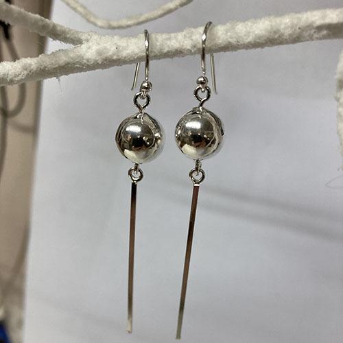 Long drop ball sterling silver earrings
