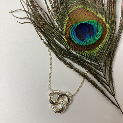 Sterling silver open Celtic design pendant on a silver chain