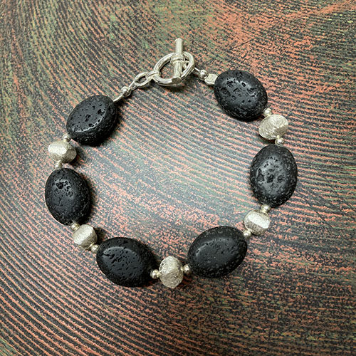Sterling silver lava bracelet with scratch effect beads
