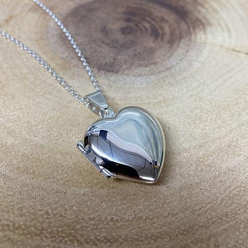 Plain sterling silver heart locket on a silver chain