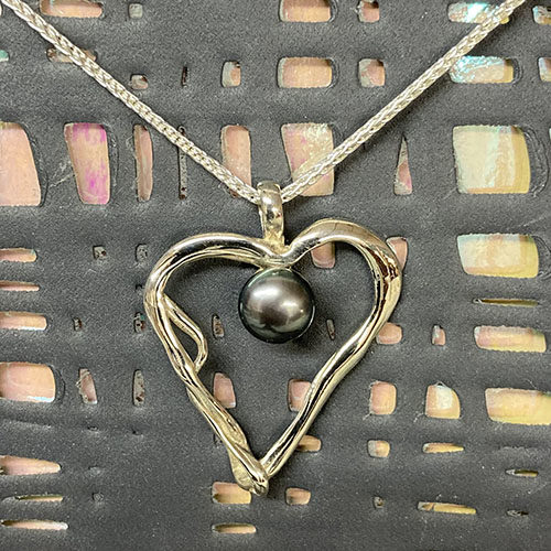 Sterling silver open heart pendant with blue pearl