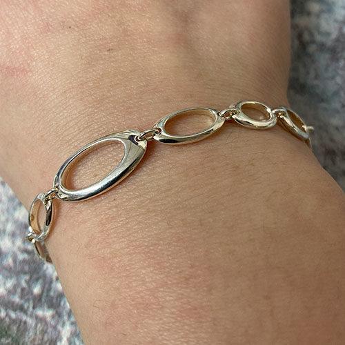 Sterling silver irregular open oval link bracelet