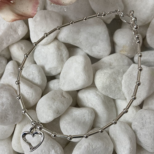 Sterling silver tube and bead bracelet with open heart charm