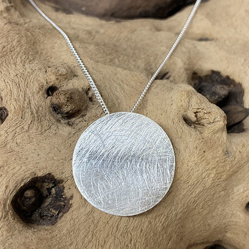 Sterling silver scratched effect round disc pendant