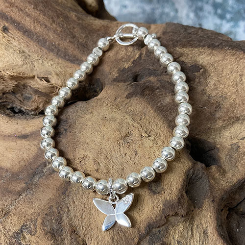 Silver bead bracelet with butterfly charm