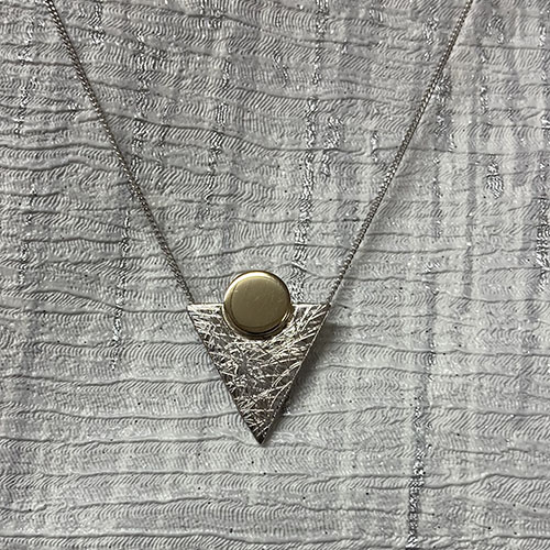 Triangle shape pendant with a scratched finish