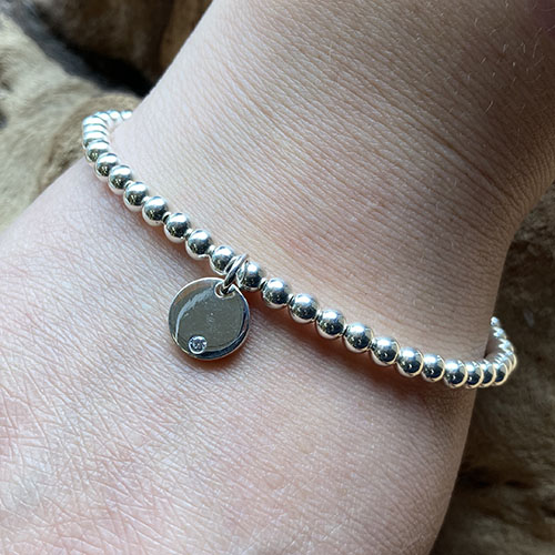 Silver bead bracelet small cubic zirconia charm