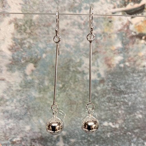 Sterling silver earrings with long drop ball