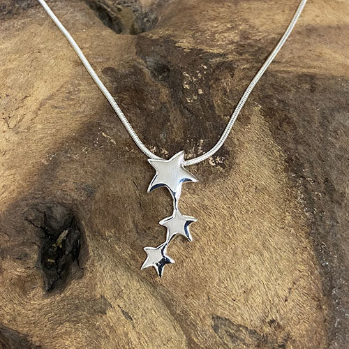 Sterling silver three star drop pendant on a silver chain