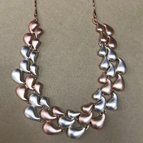 Rose gold and silver coloured costume necklace with a matt satin finish