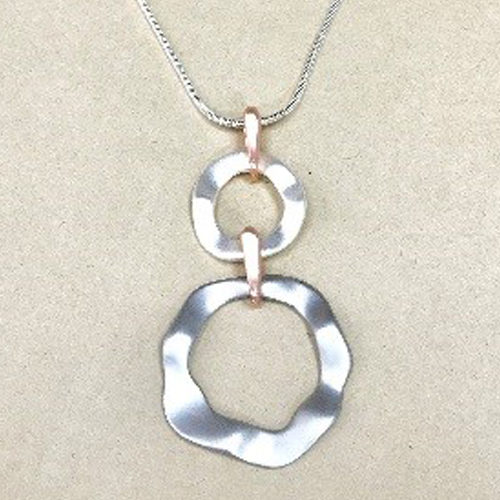 Silver and rose gold coloured necklace with two wavy circular drops