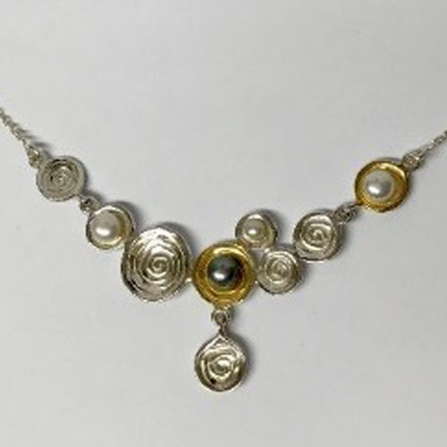 Sterling silver- and gold-plated flat disc necklace with freshwater pearls on a silver chain