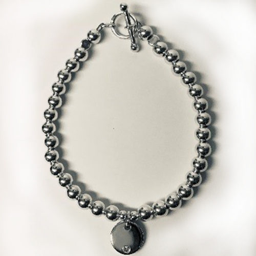 Sterling silver bead bracelet with silver disc with small cubic zirconia charm and T-bar