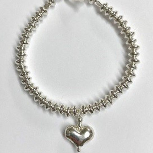 Sterling silver bracelet with rondel beads and puff heart charm